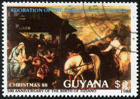 adoration: GUYANA - CIRCA 1988: a stamp printed in Guyana shows Adoration of the Magi, Painting by Titian, Christmas, circa 1988