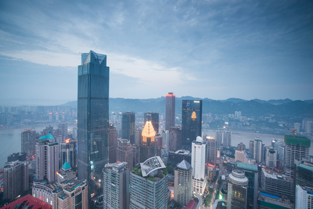 counties: CHONGQING, CHINA - August 13, 2015: Aerial view of the downtown in Chongqing . Chongqing is the largest direct-controlled municipality and comprises 19 districts, 15 counties and 4 counties.