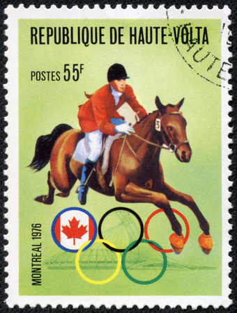 equitation: BURKINA FASO - CIRCA 1976: A stamp printed in Republic of Upper Volta, shows equitation, series Olympic Games, Montreal, Canada, circa 1976 Editorial
