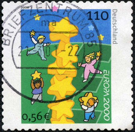 circa: A stamp printed in the Germany shows Children and Stars, circa 2000