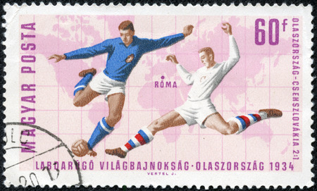 soccer world cup: stamp printed in Hungary celebrates Soccer world cup showing illustration of soccer players, circa 1966 Editorial