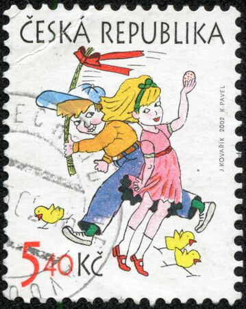 ceska: Printed stamp in Czechoslovakia Ceska shows symbols of Easter boy running with whip willow girl with painted egg tree chicks Scott 31675 circa 40K 2002
