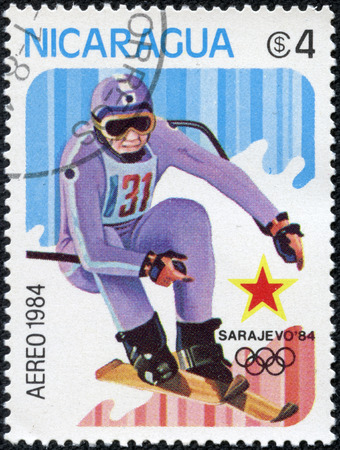 downhill skiing: stamp printed in Nicaragua shows Downhill skiing, circa 1984 Editorial