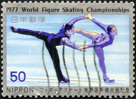 CHONGQING, CHINA - May 8, 2014:A stamp printed in Japan shows male and female skating on ice, series World Figure skating championship, circa 1977.