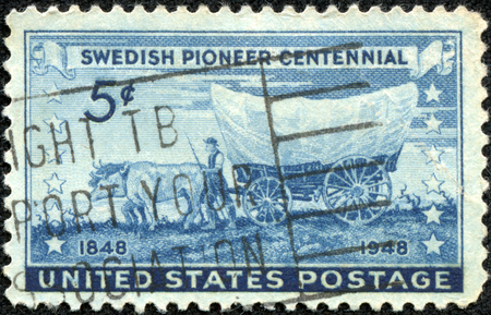 A stamp printed in USA shows the Pioneer with Covered Wagon moving Westward, Swedish Pioneer Issue, circa 1948