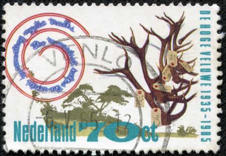 CHONGQING, CHINA - May 9, 2014:A stamp printed in Netherlands shows antlers with tags, circa 1985 Stock Photo