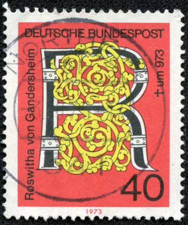 bundespost: CHONGQING CHINA - May 92014 A printed Germany issued the death anniversary Roswitha von poetess shows a motif with letter R of circa 1973 in in, Gandersheim