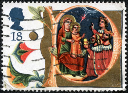 CHONGQING, CHINA - May 9, 2014:A stamp printed in United Kingdom from the Christmas  issue shows Adoration of the Magi, Manuscript in Bodleian Library, Oxford, circa 1991. Stock Photo