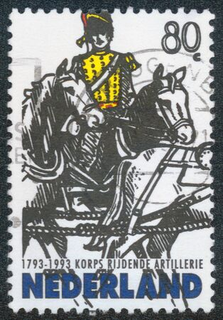 hussar: CHONGQING, CHINA - November 29, 2014:A stamp printed in Netherlands shows rider on horses on white background, 1993 Stock Photo