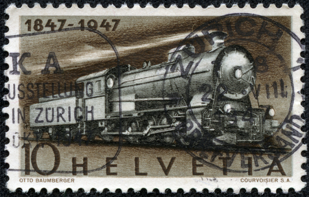 CHONGQING, CHINA - May 9, 2014: A stamp printed in Switzerland shows image of a Steam Freight Locomotive, circa 1947