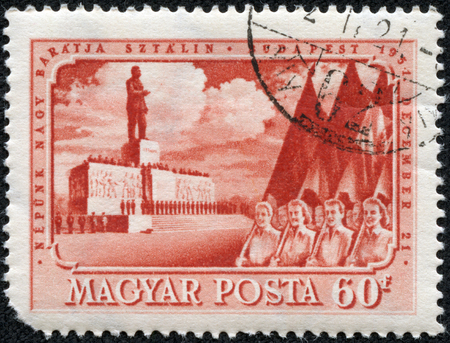 CHONGQING, CHINA - May 9, 2014:A Stamp printed in Hungary shows May Day demonstration in Budapest against the backdrop of the monument to Joseph Stalin, circa 1951