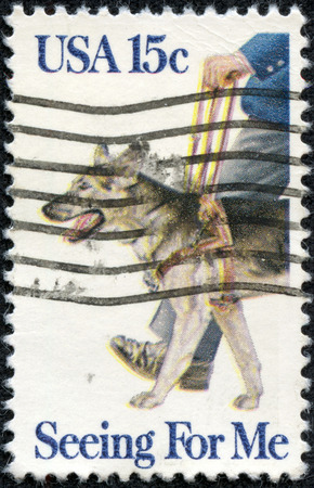 CHONGQING, CHINA - May 9, 2014:A stamp printed in the USA shows guide dog, Seeing for me, circa 1979