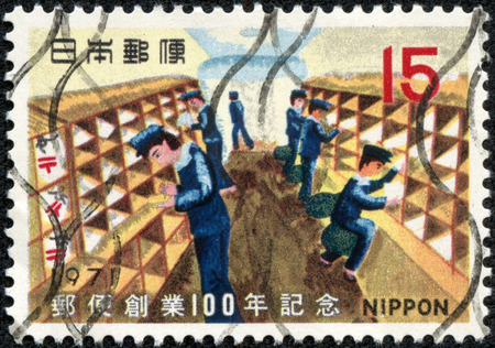 CHONGQING, CHINA - May 9, 2014:A postage stamp printed in Japan shows railway mail post office, series Philatelic Week, circa 1971.