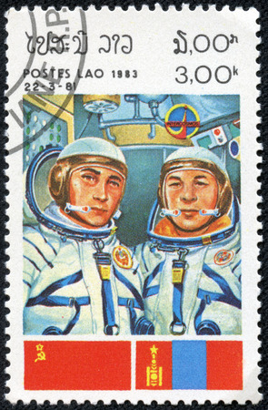 CHONGQING, CHINA - May 9, 2014: A stamp printed in the Laos, a symbol INTERCOSMOS - Space Cooperation Program of the USSR - Mongolia, circa 1983