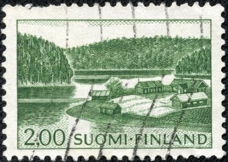 circa: stamp printed by Finland, shows Farm on Lake Shore, circa 1964