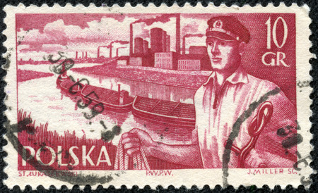 stamp printed in Poland from the Merchant Navy issue shows sailor and barges, circa 1956.
