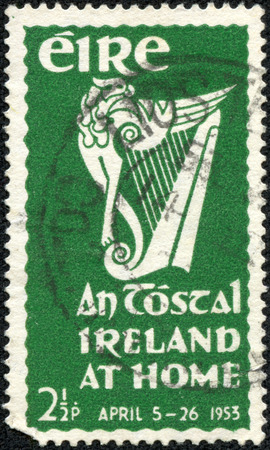 A stamp printed in Ireland shows An Tostal Ireland at home, circa 1953