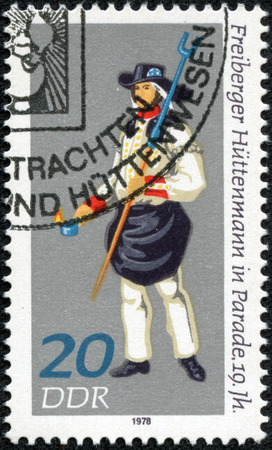 metallurgist: Stamp printed in East shows costumes miners and in the XIX V Metallurgist of the of Freiberg circa 1978 GDR Germany Ceremonial Stock Photo