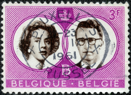 baudouin: CHONGQING, CHINA - May 10, 2014:a stamp printed By Belgium shows King Baudouin and Queen Fabiola, circa 1960