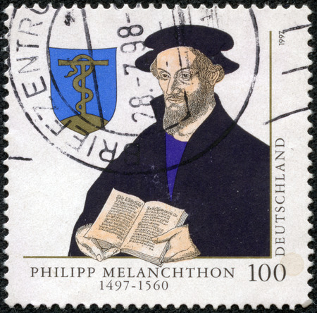 CHONGQING, CHINA - May 10, 2014:A stamp printed in Germany, shows portrait of Philipp Melanchthon 1497-1560, Protestant Reformer, circa 1997