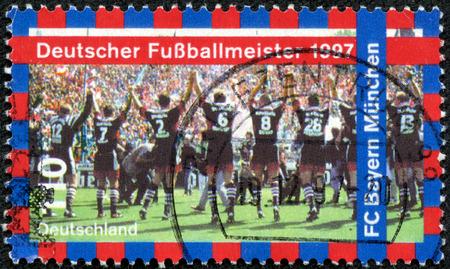 CHONGQING, CHINA - May 10, 2014:A postage stamp of GERMANY shows FC Bayern Munchen, 1997 German Soccer Champions, circa 1997