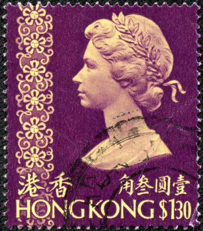 CHONGQING, CHINA - May 10, 2014:A stamp printed in Hong Kong showing a portrait of Queen Elizabeth II, circa 1973.