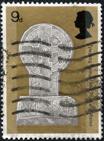 CHONGQING, CHINA - May 10, 2014:stamp printed by Great Britain, shows Celtic Cross Margam Abbey Glamorgan, circa 1969. Editöryel