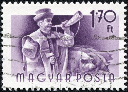 重慶, 中国 - 5 月 10 日 2014:stamp Magyar の印刷は、ホーン飼い羊飼い鳴らす 報道画像