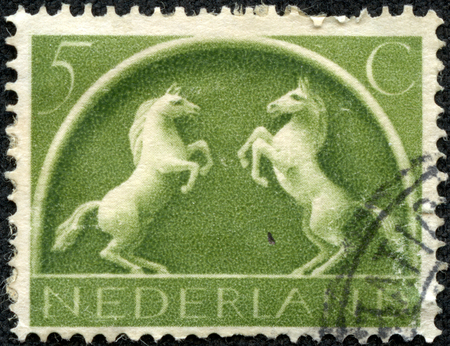 Stamp printed in Netherlands shows Old Germanic Symbol two prancing horses, circa 1943 Stock Photo