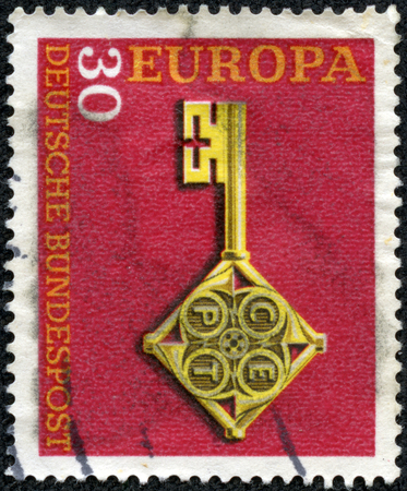 CHONGQING, CHINA - May 10, 2014:A stamp printed in the Germany shows Golden Key with C.E.P.T Emblem, Europe, circa 1968 Stok Fotoğraf