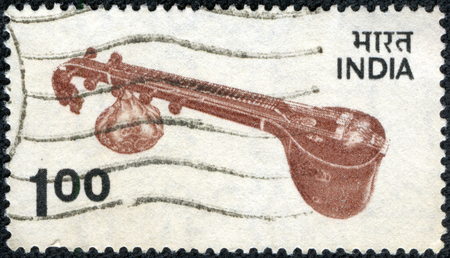 philatelic: CHONGQING, CHINA - May 10, 2014:A stamp printed in India, shows Veena - plucked string instrument used in Hindustani classical music, circa 1974 Stock Photo