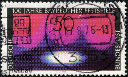 CHONGQING, CHINA - May 10, 2014: A stamp printed in German Federal Republic honoring Centenary of Bayreuth Festival, Wagnerian Stage, circa 1976