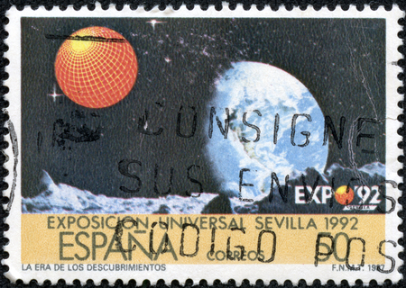 CHONGQING, CHINA - May 10, 2014: a stamp printed in the Spain shows Earth, Moons Surface, EXPO 92, Seville, circa 1987 Stok Fotoğraf