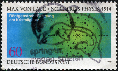 CHONGQING, CHINA - May 10, 2014:A postage stamp of GERMANY shows Atom Arrangement in Crystals, Max von Laue, Nobel Lauerate in Physics, circa 1979 Stok Fotoğraf