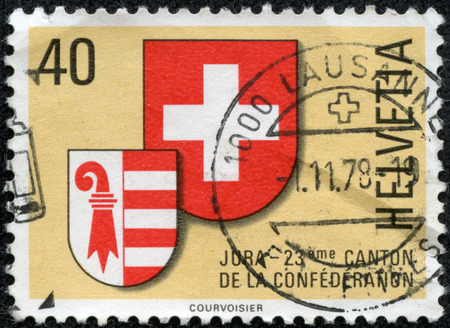helvetia: A post stamp printed in SWITZERLAND shows coat of arms of Jura canton, circa 1978