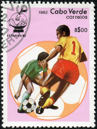 CHONGQING, CHINA - May 10, 2014:A stamp printed in Cabo Verde from the ESPANA 1982 World Soccer Cup Winners  issue shows two football players, circa 1982