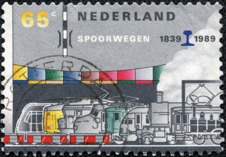 HOLLAND - CIRCA 1980: Stamp printed in the Netherlands shows several trains of the dutch railroad services, circa 1980 Stok Fotoğraf