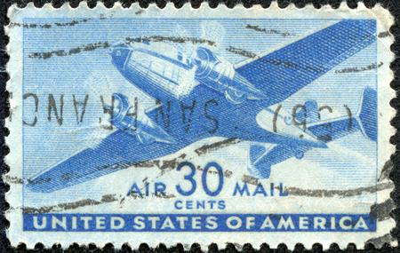 USA - CIRCA 1941: A Stamp printed in USA shows the Twin-Motored Transport Plane, circa 1941 Stok Fotoğraf