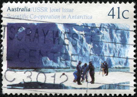 CHONGQING, CHINA - May 10, 2014: a stamp printed in Australia shows Scientific research in Antarctica , USSR - Australia - Scientific cooperation in Antarctica, series, circa 1990