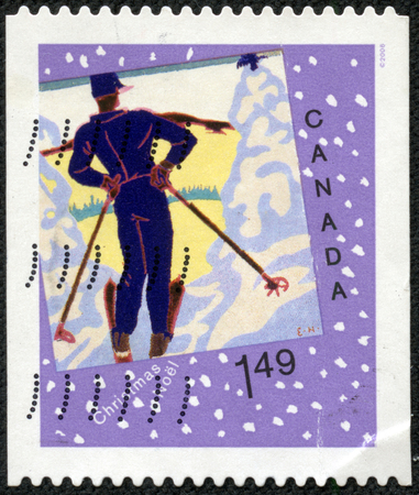 CHONGQING, CHINA - May 10, 2014:A stamp printed in Canada worth $1.49 shows image of a man on skis, series, 2006