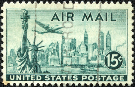CHONGQING, CHINA - May 10, 2014:A stamp printed in United States of America shows Statue of Liberty on the background the skyscrapers of New York, airliner Lockheed Constellation, circa 1947