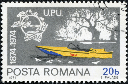 CHONGQING, CHINA - May 10, 2014:a stamp printed in Romania shows Mail motorboat, Centenary of UPU, circa 1974