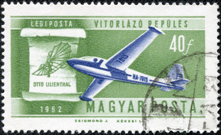 CHONGQING, CHINA - May 10, 2014:a stamp printed in Hungary shows Glider and Lilienthals Design, Flight Development, circa 196