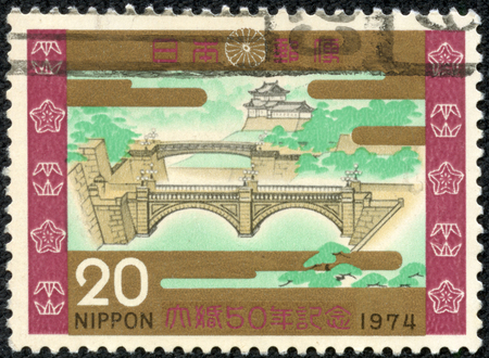 CHONGQING, CHINA - May 10, 2014:A postage stamp printed in Japan shows double bridge at the palace, series Golden wedding of emperor Hirohito , circa 1974.