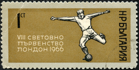 CHONGQING, CHINA - May 10, 2014:A stamp printed in Bulgaria shows football player kicks the ball, dedicated to the World Cup in London in 1966, circa 1966