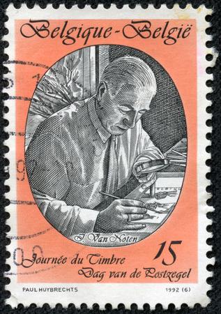 CHONGQING, CHINA - May 10, 2014:A stamp printed by Belgium, shows Jean Van Noten, Stamp Designer, circa 1992 Editöryel