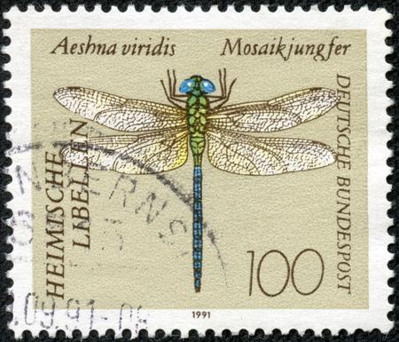 A stamp printed in Germany, shows Green Hawker (Aeshna viridis), circa 1991 Stok Fotoğraf