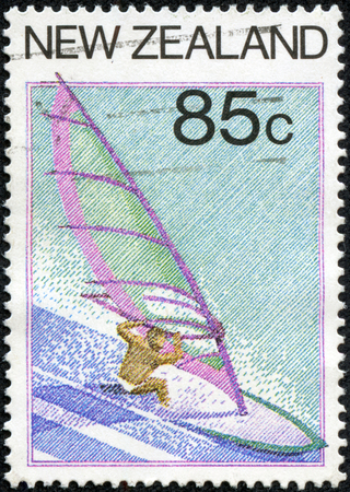 A stamp printed in New Zealand from the Tourism  issue shows Windsurfing, circa 1987. Stock Photo