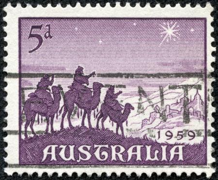 CHONGQING, CHINA - May 10, 2014:a stamp printed in the Australia shows Approach of the Magi, Christmas, circa 1959 Editöryel