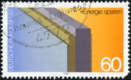 CHONGQING, CHINA - May 10, 2014:A stamp printed in Germany, dedicated to the conservation of energy, shows insulated wall, circa 1982